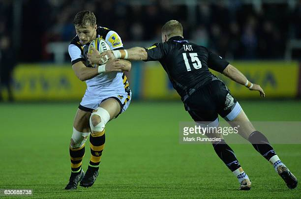 Josh Bassett of Wasps is tackled by Alex Tait of Newcastle Falcons during he Aviva Premiership match between Newcastle Falcons and Wasps at Kingston...
