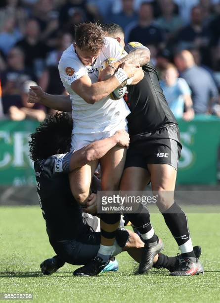 Josh Bassett of Wasps is tackled by Juan Pablo Socino of Newcastle Falcons during the Aviva Premiership match between Newcastle Falcons and Wasps at...
