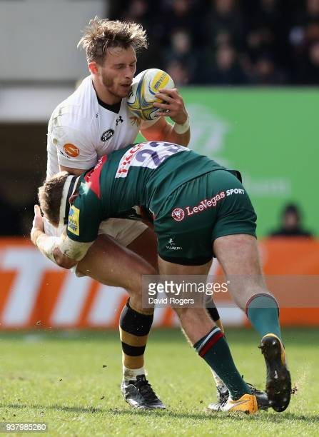 Josh Bassett of Wasps is tackled by Nick Malouf during the Aviva Premiership match between Leicester Tigers and Wasps at Welford Road on March 25...