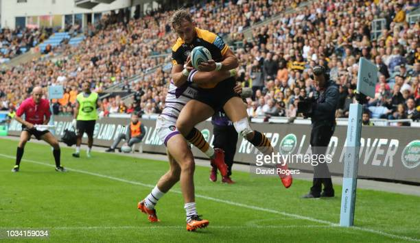 Josh Bassett of Wasps out jumps Adam Thompstone to score their second try during the Gallagher Premiership Rugby match between Wasps and Leicester...