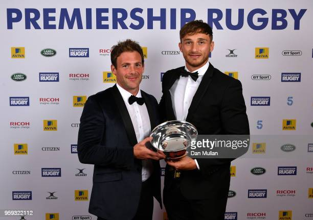 Josh Bassett of Wasps receives the Singha Premiership Rugby 7s player of the Season award from Rob Vickerman during the Premiership Rugby Awards 2018...