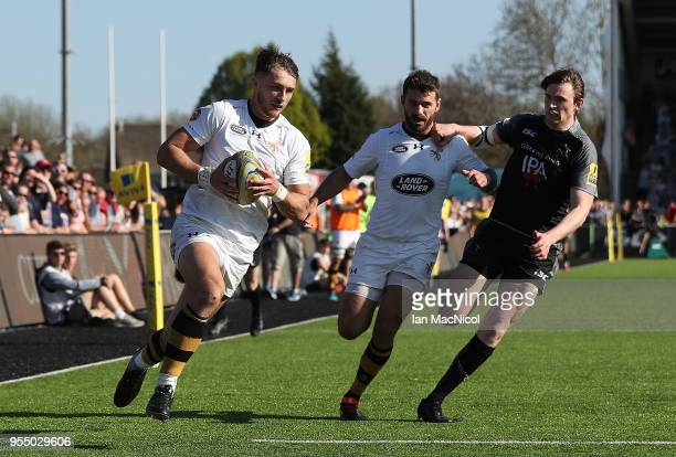 Josh Bassett of Wasps runs through to scores his team's fourth try during the Aviva Premiership match between Newcastle Falcons and Wasps at Kingston...