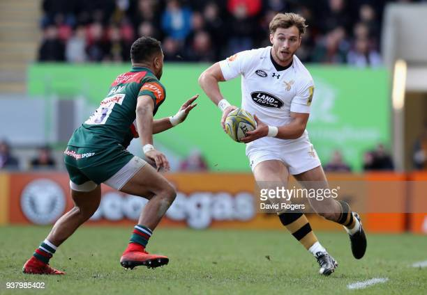 Josh Bassett of Wasps runs with the ball during the Aviva Premiership match between Leicester Tigers and Wasps at Welford Road on March 25 2018 in...
