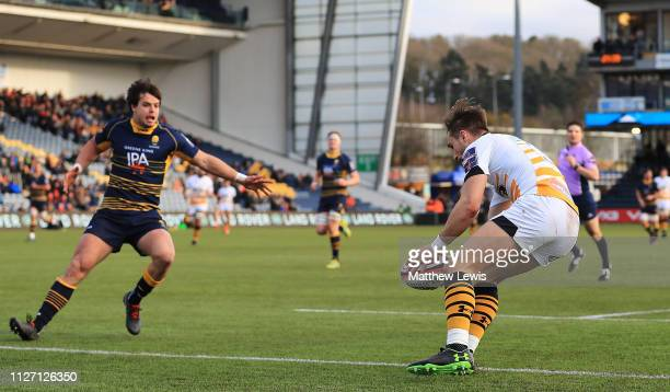 Josh Bassett of Wasps scores a try during the Premiership Rugby Cup match between Worcester Warriors and Wasps at Sixways Stadium on February 03 2019...