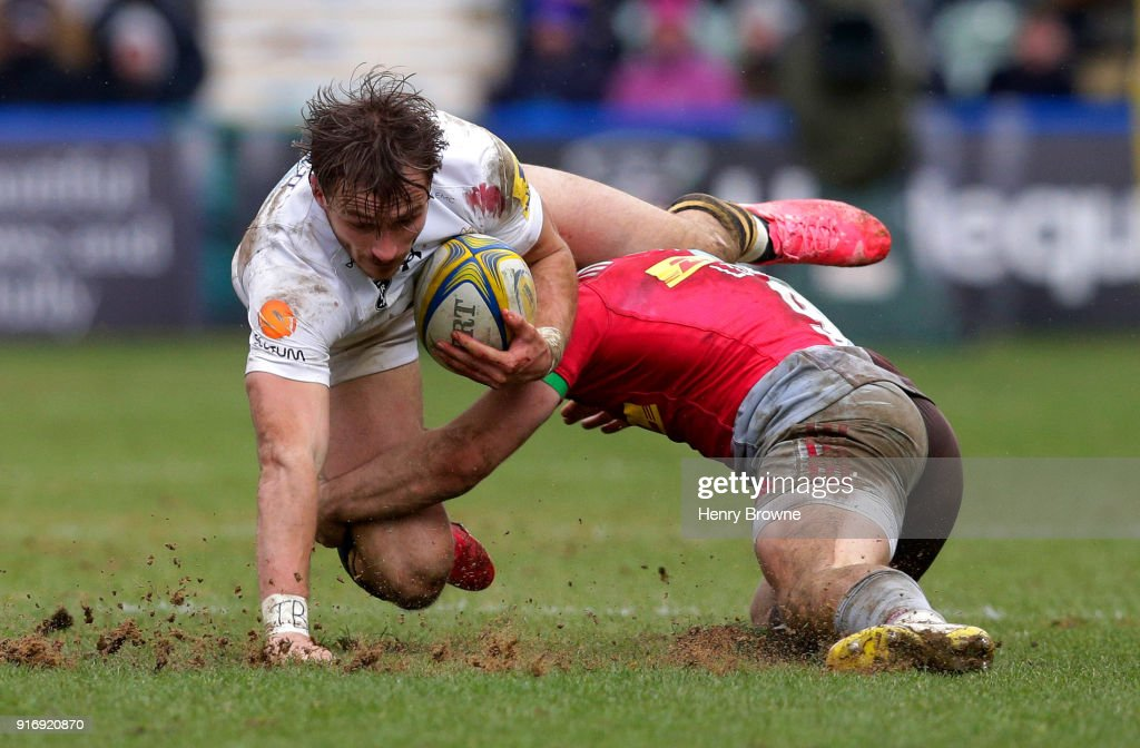 Josh Bassett of Wasps tackled by Dave Lewis of Harlequins during the Aviva Premiership match between Harlequins and Wasps at Twickenham Stoop on February 11, 2018 in London, England.