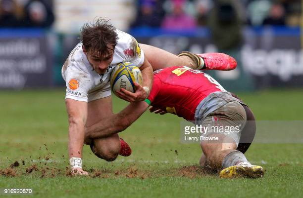 Josh Bassett of Wasps tackled by Dave Lewis of Harlequins during the Aviva Premiership match between Harlequins and Wasps at Twickenham Stoop on...