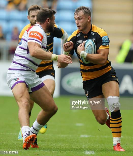 Josh Bassett of Wasps takes on Adam Thompstone during the Gallagher Premiership Rugby match between Wasps and Leicester Tigers at the Ricoh Arena on...