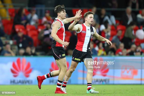 Josh Battle of the Saints celebrates a goal during the round 13 AFL match between the Gold Coast Suns and the St Kilda Saints at Metricon Stadium on...