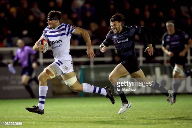 Josh Bayliss of Bath Rugby breaks away to score a try during the Premiership Rugby Cup match between Newcastle Falcons and Bath Rugby at Kingston...