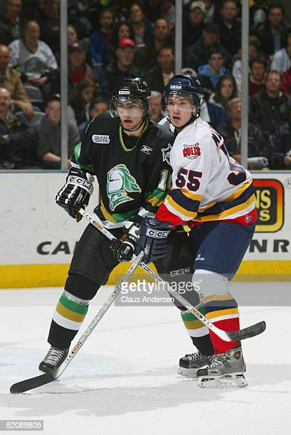 Josh Beaulieu of the London Knights and Andrew Marshall of the Barrie Colts vie for position during the Ontario Hockey League game at John Labatt...