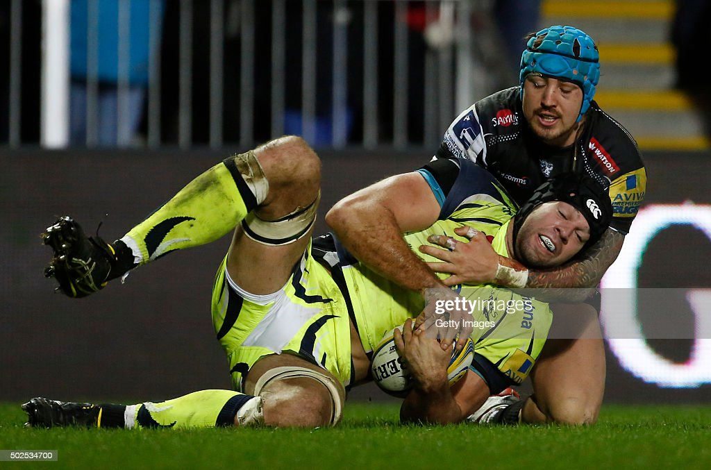 Josh Beaumont of Sale Sharks is tackled by Jack Nowell of Exeter Chiefs during the Exeter Chiefs v Sale sharks Aviva Premiership Match at Sandy Park on December 26, 2015 in Exeter, England.