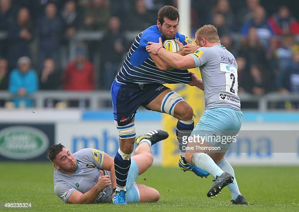 Josh Beaumont of Sale Sharks is tackled by Kieran Brookes of Northampton Saints, left, and Mikey Haywood of Northampton Saints during the Aviva...