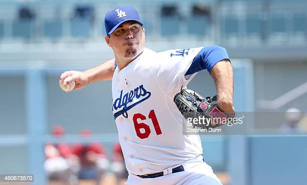 Josh Becket of the Los Angeles Dodgers throws a pitch against the Arizona Diamondbacks at Dodger Stadium on June 15, 2014 in Los Angeles, California.