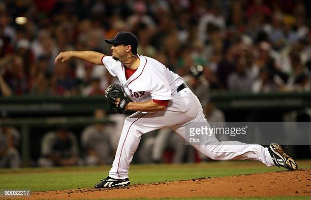 Josh Beckett of the Boston Red Sox delivers a pitch against the New York Yankees on August 23, 2009 at Fenway Park in Boston, Massachusetts.