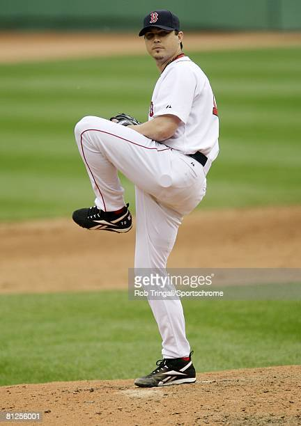 Josh Beckett of the Boston Red Sox pitches against the Milwaukee Brewers on May 18 2008 at Fenway Park in Boston Massachusetts The Red Sox defeated...