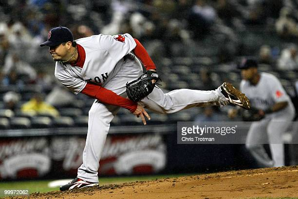 Josh Beckett of the Boston Red Sox pitches against the New York Yankees on May 18, 2010 at Yankee Stadium in the Bronx borough of New York City.