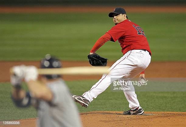Josh Beckett of the Boston Red Sox throws against the Tampa Bay Rays at Fenway Park September 16, 2011 in Boston, Massachusetts.