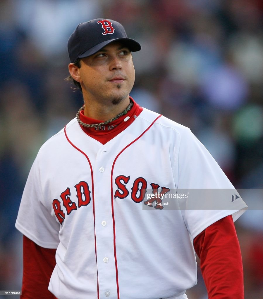 Josh Beckett #19 of the Boston Red Sox walks to the dugout between innings during a game against the New York Yankees on September 15, 2007 at Fenway Park in Boston, Massachusetts.