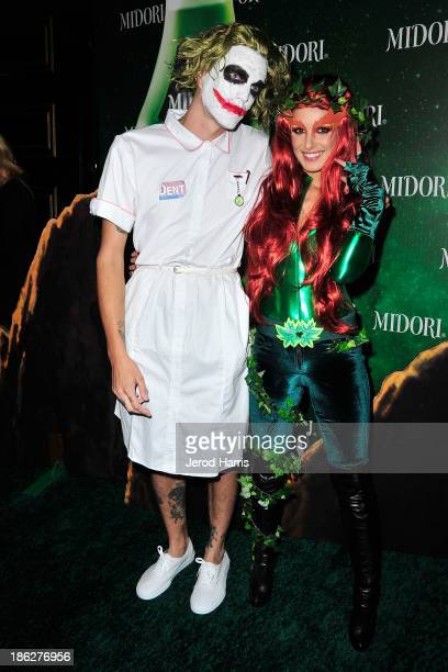 Josh Beech and Shenae Grimes arrive at the 3rd Annual Midori Green Halloween at Bootsy Bellows on October 29 2013 in West Hollywood California