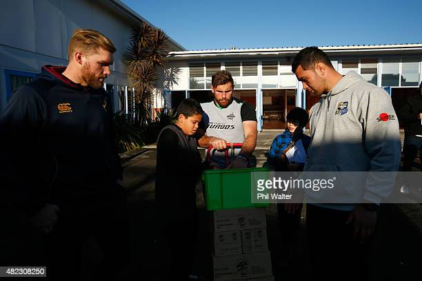 Josh Bekhuis of Southland Callum Gibbons of Manawatu and Carl Axtons of Bay of Plenty deliver milk to school children at New Windsor School before...