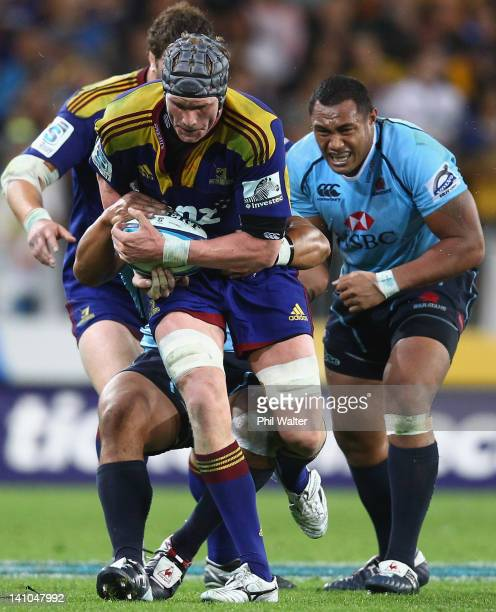 Josh Bekhuis of the Highlanders makes a break during the round three Super Rugby match between the Highlanders and the Waratahs at Forsyth Barr...