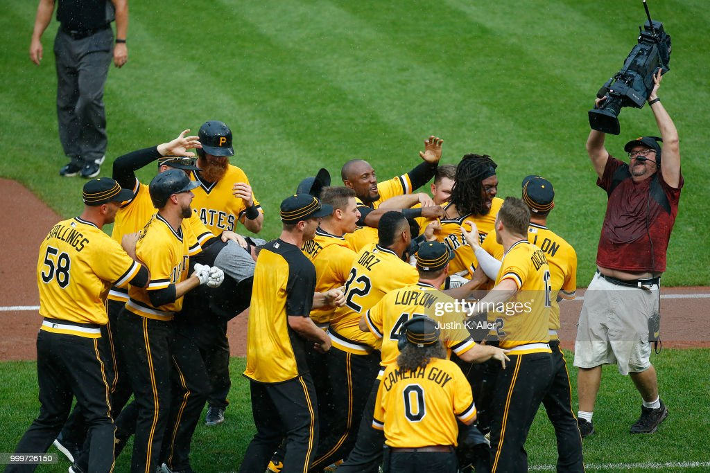 Josh Bell #55 of the Pittsburgh Pirates celebrates after hitting a two RBI double in the tenth inning against the Milwaukee Brewers at PNC Park on July 15, 2018 in Pittsburgh, Pennsylvania.