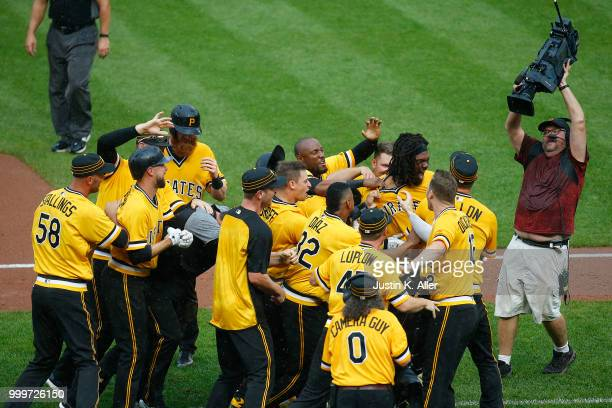 Josh Bell of the Pittsburgh Pirates celebrates after hitting a two RBI double in the tenth inning against the Milwaukee Brewers at PNC Park on July...