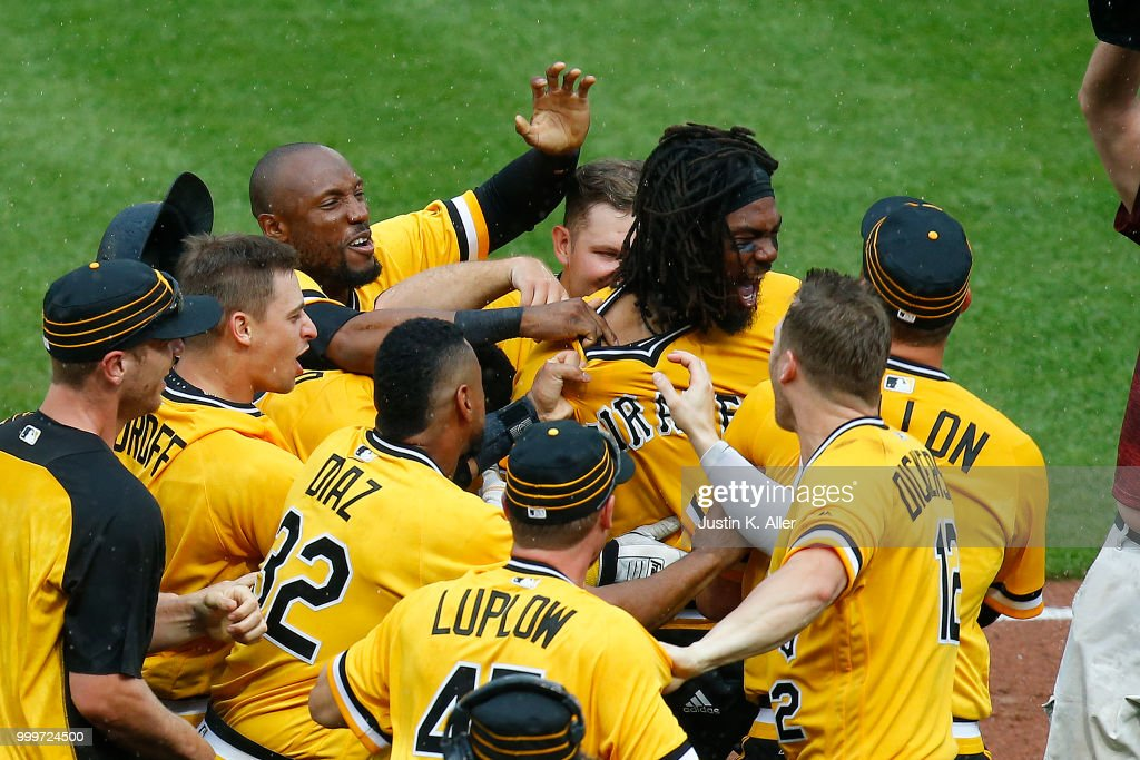 Josh Bell #55 of the Pittsburgh Pirates celebrates after hitting a walk off two RBI double in the tenth inning against the Milwaukee Brewers at PNC Park on July 15, 2018 in Pittsburgh, Pennsylvania.