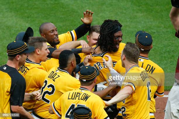Josh Bell of the Pittsburgh Pirates celebrates after hitting a walk off two RBI double in the tenth inning against the Milwaukee Brewers at PNC Park...
