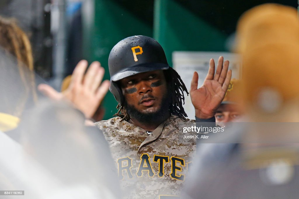 Josh Bell #55 of the Pittsburgh Pirates celebrates after scoring on a RBI single in the third inning against the St. Louis Cardinals at PNC Park on August 17, 2017 in Pittsburgh, Pennsylvania.