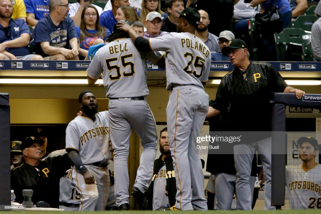 Josh Bell #55 of the Pittsburgh Pirates celebrates with teammates after hitting a home run in the sixth inning against the Milwaukee Brewers at Miller Park on June 21, 2017 in Milwaukee, Wisconsin.