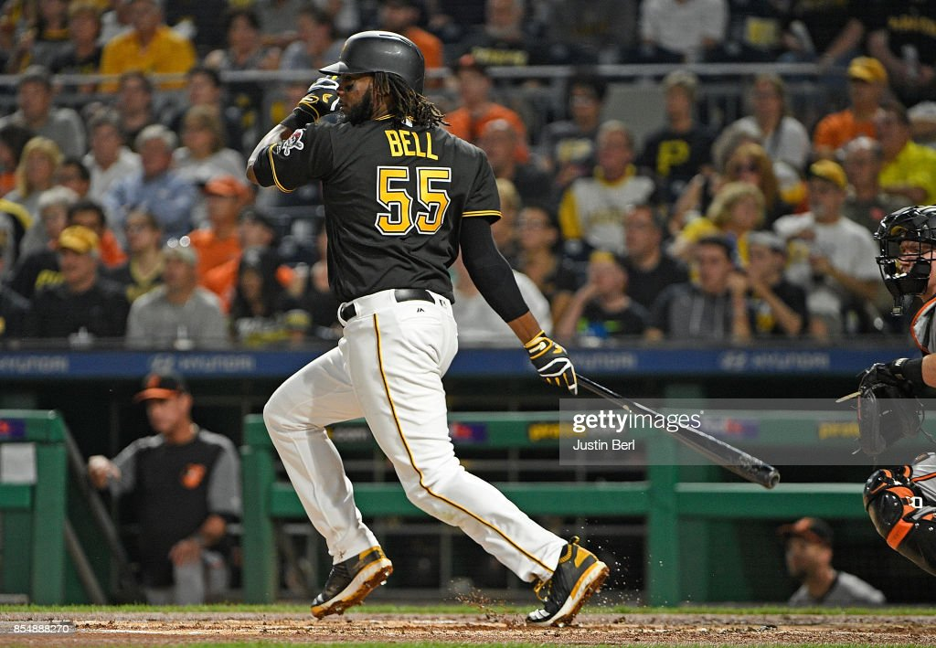Josh Bell #55 of the Pittsburgh Pirates hits a single to left field in the first inning during the game against the Baltimore Orioles at PNC Park on September 27, 2017 in Pittsburgh, Pennsylvania.