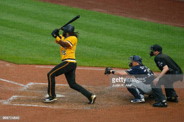 Josh Bell of the Pittsburgh Pirates hits a walk off two RBI double in the tenth inning against the Milwaukee Brewers at PNC Park on July 15 2018 in...