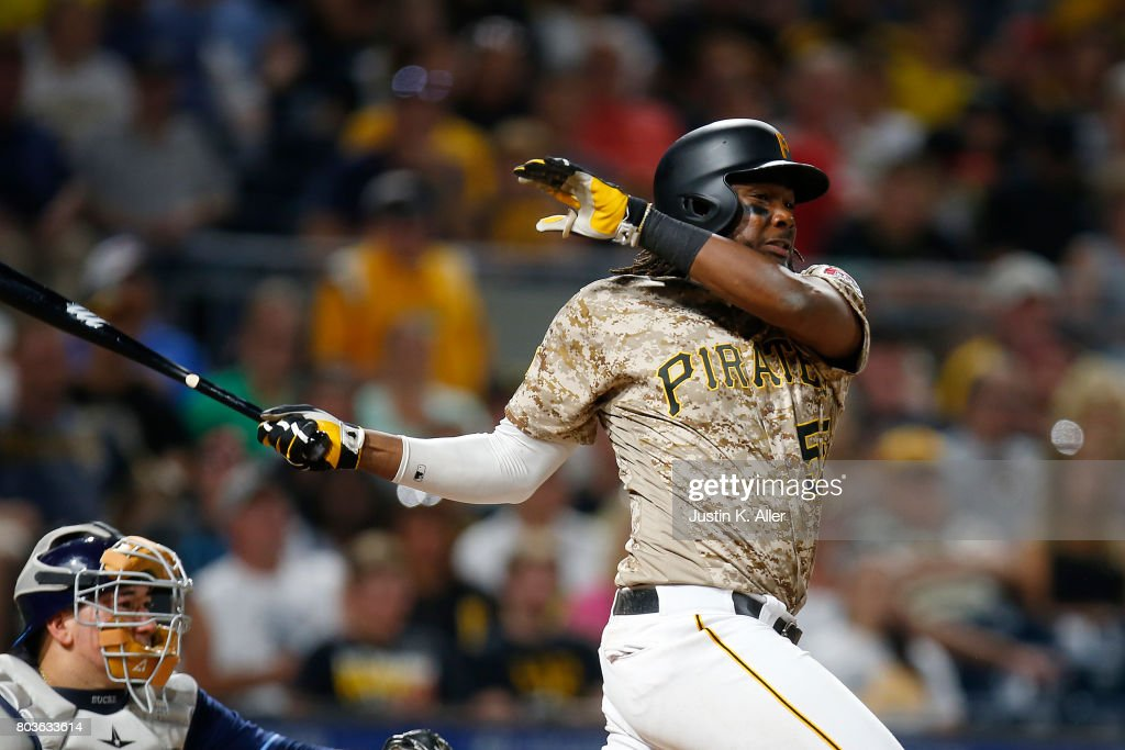 Josh Bell #55 of the Pittsburgh Pirates hits an RBI single in seventh inning against the Tampa Bay Rays during inter-league play at PNC Park on June 29, 2017 in Pittsburgh, Pennsylvania.