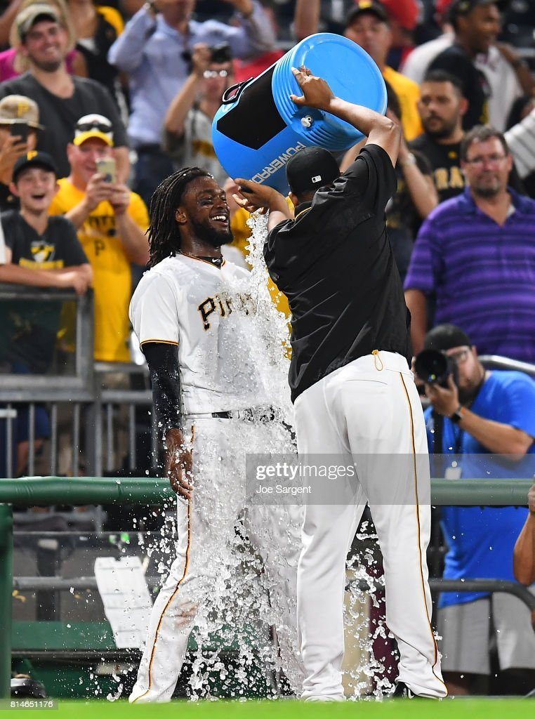 Josh Bell #55 of the Pittsburgh Pirates is showered with ice after his three run home run during the ninth inning against the St. Louis Cardinals at PNC Park on July 14, 2017 in Pittsburgh, Pennsylvania. Pittsburgh won the game 5-2.