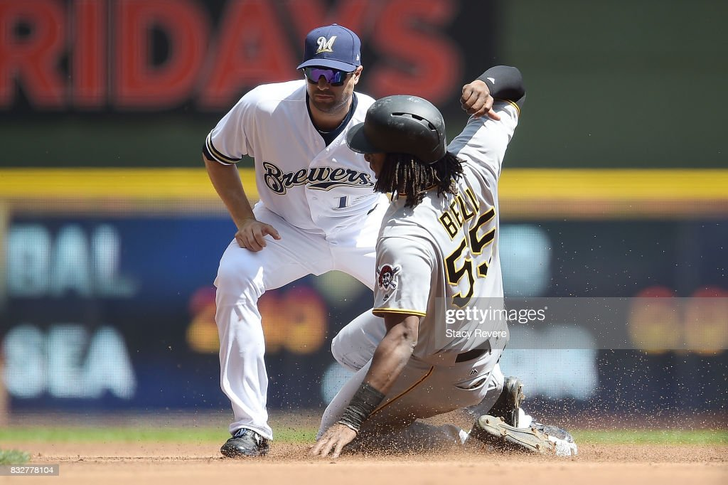 Josh Bell #55 of the Pittsburgh Pirates is tagged out at second base by Neil Walker #15 of the Milwaukee Brewers during the first inning at Miller Park on August 16, 2017 in Milwaukee, Wisconsin.