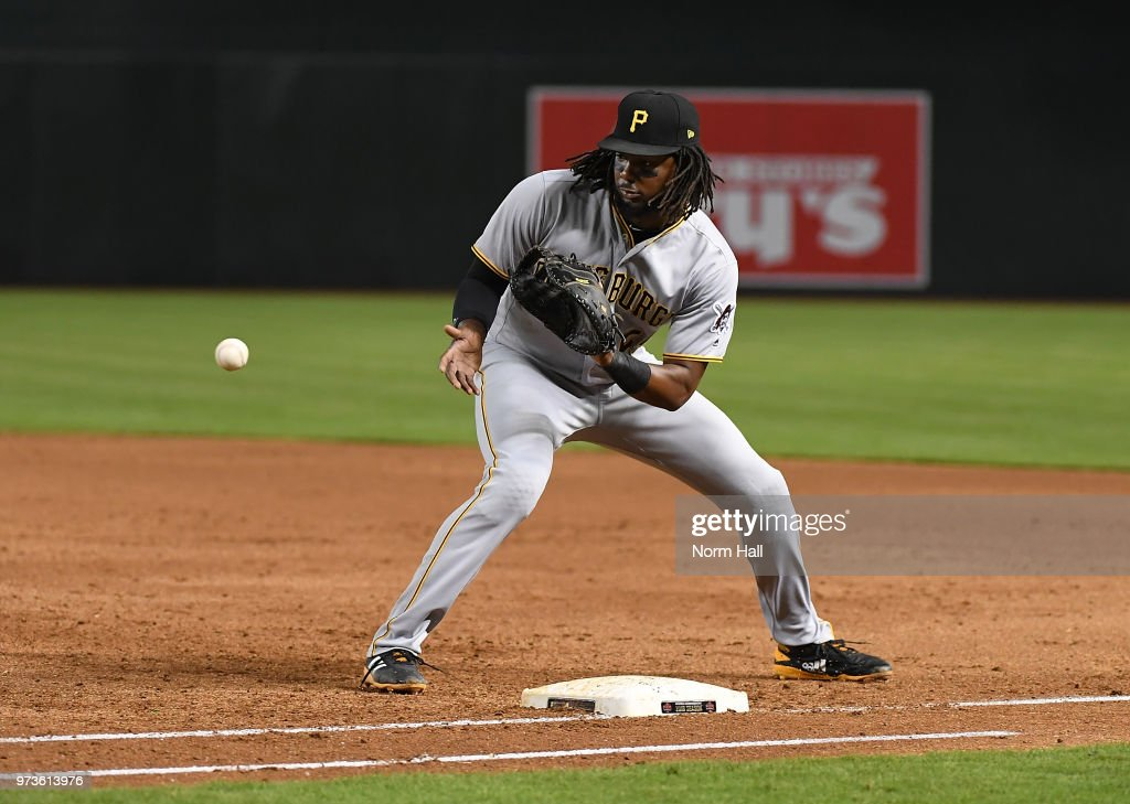 Josh Bell #55 of the Pittsburgh Pirates makes a play on a ground ball at first base in the third inning against the Arizona Diamondbacks at Chase Field on June 13, 2018 in Phoenix, Arizona.