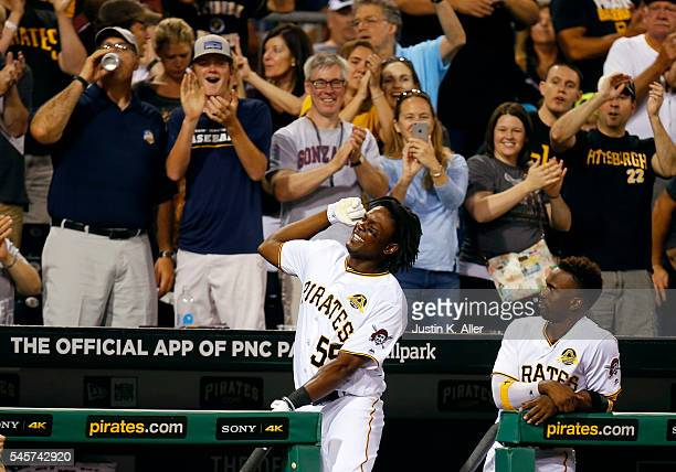 Josh Bell of the Pittsburgh Pirates reacts after hitting a grand slam home run in the fifth inning during the game against the Chicago Cubs at PNC...