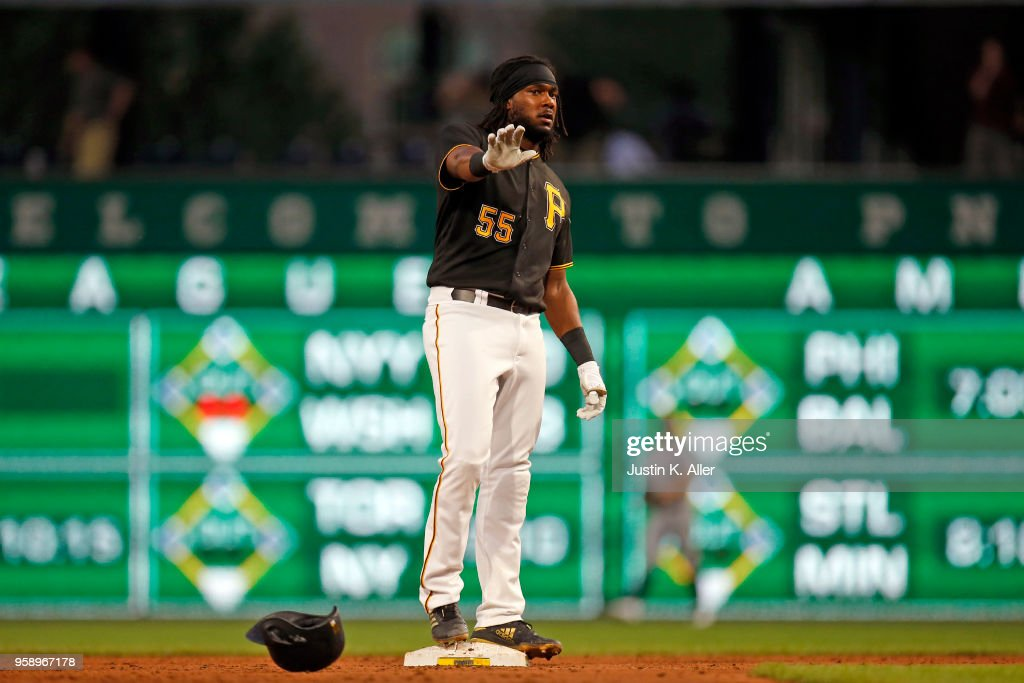 Josh Bell #55 of the Pittsburgh Pirates reacts after hitting an RBI double in the second inning against the Chicago White Sox during inter-league play at PNC Park on May 15, 2018 in Pittsburgh, Pennsylvania.