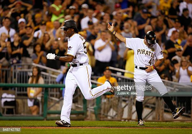 Josh Bell of the Pittsburgh Pirates rounds third after hitting a grand slam home run in the fifth inning during the game against the Chicago Cubs at...