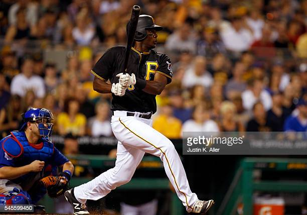 Josh Bell of the Pittsburgh Pirates singles in the seventh inning for his first major league hit in the seventh inning during the game against the...