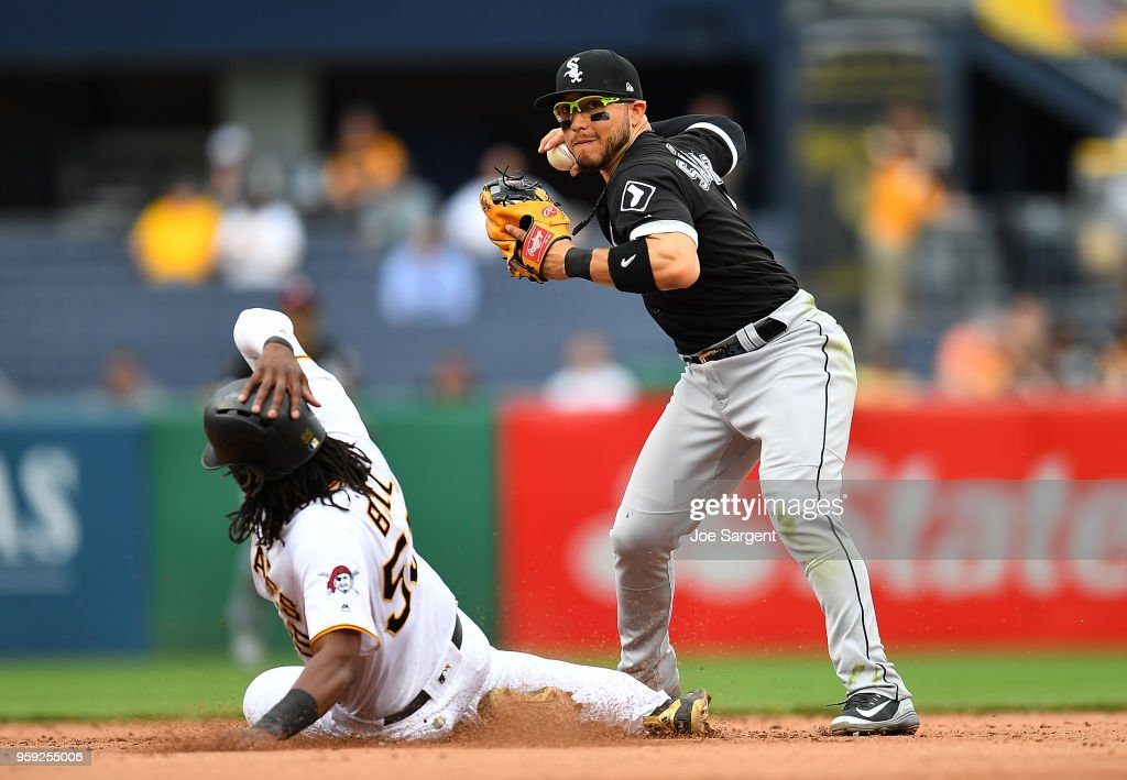Josh Bell #55 of the Pittsburgh Pirates slides safely into second base in front of Yolmer Sanchez #5 of the Chicago White Sox in the seventh inning during inter-league play at PNC Park on May 16, 2018 in Pittsburgh, Pennsylvania.