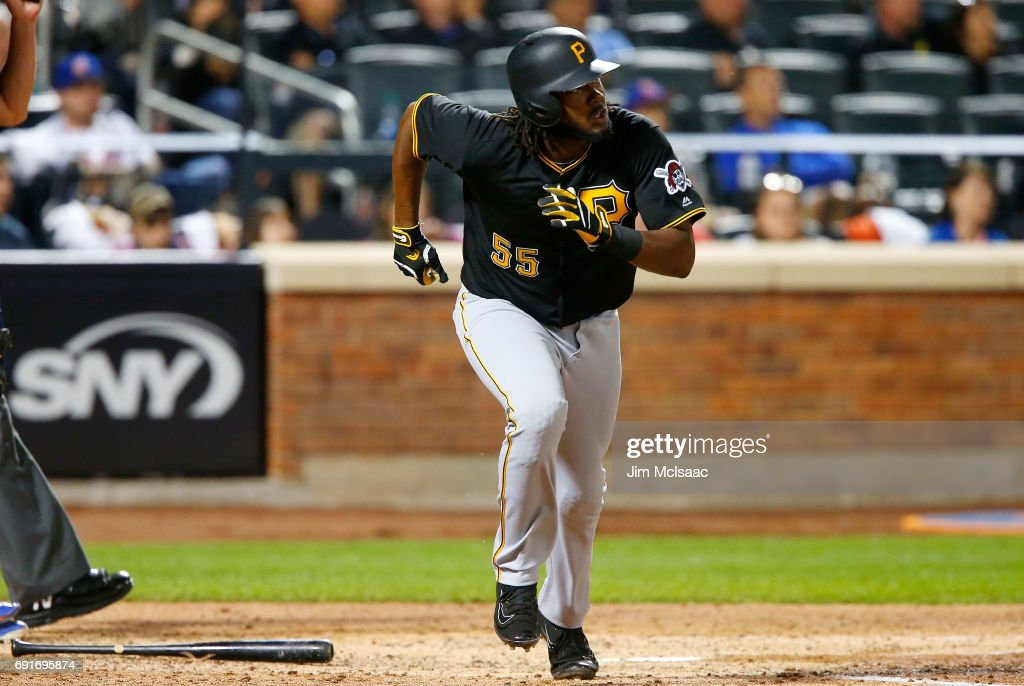 Josh Bell #55 of the Pittsburgh Pirates watches the flight of his sixth inning home run against the New York Mets at Citi Field on June 2, 2017 in the Flushing neighborhood of the Queens borough of New York City.
