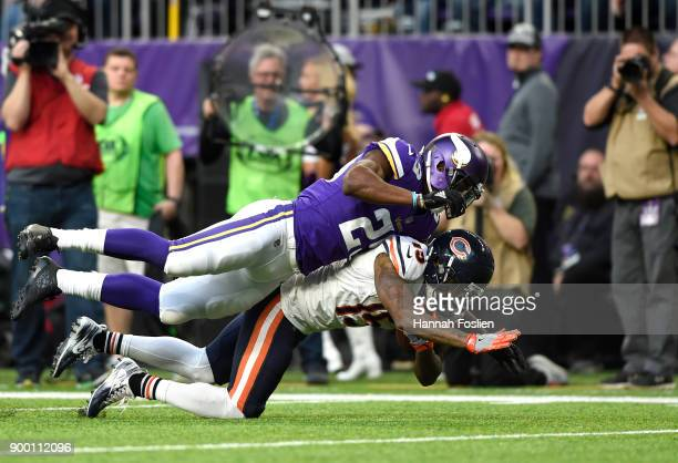Josh Bellamy of the Chicago Bears is tackled with the ball by Xavier Rhodes of the Minnesota Vikings in the fourth quarter of the game on December 31...