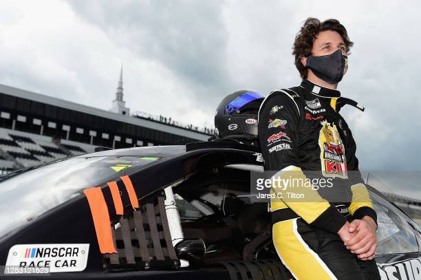 Josh Bilicki driver of the Insurance King Chevrolet stands on the grid prior to the NASCAR Cup Series Pocono 350 at Pocono Raceway on June 28 2020 in...