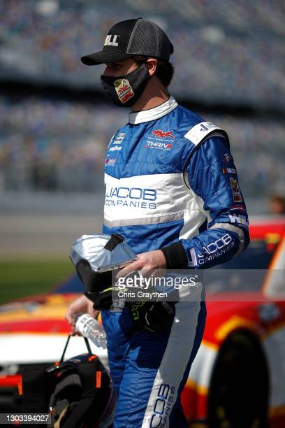 Josh Bilicki, driver of the Jacob Companies Ford, walks the grid prior to the NASCAR Cup Series O'Reilly Auto Parts 253 at Daytona International...