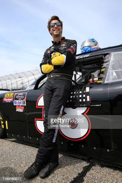 Josh Bilicki driver of the Larrys Hard Lemonade Chevrolet stands on the grid during qualifying for the NASCAR Xfinity Series ROXOR 200 at New...