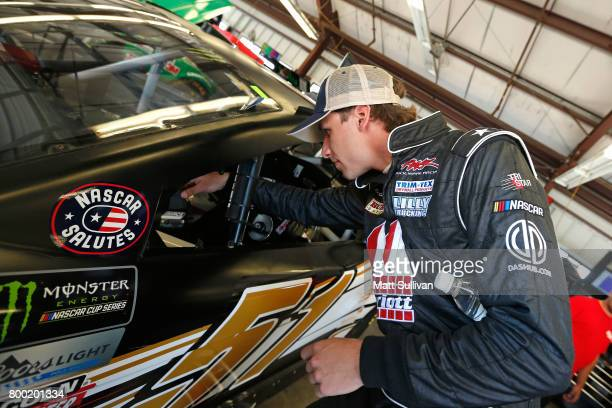 Josh Bilicki driver of the Marriott Drywall Materials Chevrolet gets into his car during practice for the Monster Energy NASCAR Cup Series...