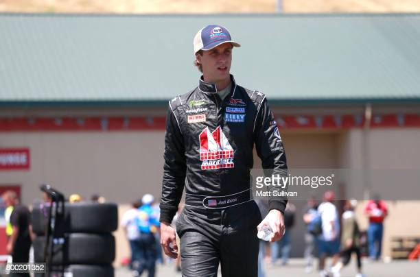 Josh Bilicki driver of the Marriott Drywall Materials Chevrolet walks to his car during practice for the Monster Energy NASCAR Cup Series Toyota/Save...