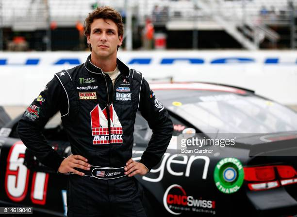 Josh Bilicki driver of the Prevagen Chevrolet stands on the grid during qualifying for the Monster Energy NASCAR Cup Series Overton's 301 at New...